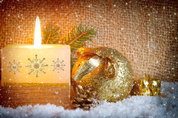 Christmas golden  background with white advent candle.