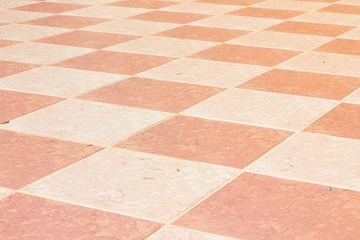 old and pale ceramic tiled floor of temple in thailand, outdoor