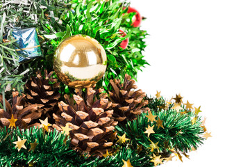 Synthetic Christmas tree with colored balls on branches and fir