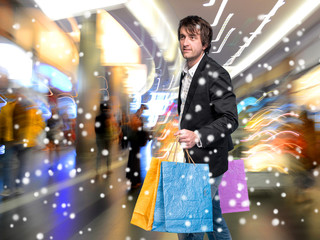 Handsome young man with shopping bags