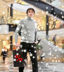 Smiling man  with shopping bag