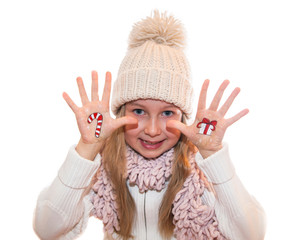 Little girl demonstrating  Christmas symbols, painted on hands