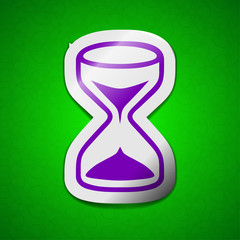 hourglass icon sign. Symbol chic colored sticky label on green