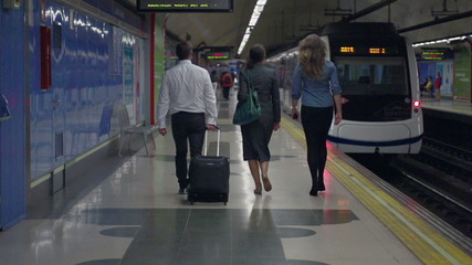 Business colleagues walking on platform, slow motion, steadycam