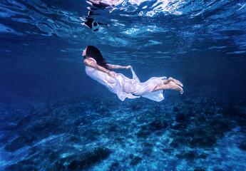 Swimming in beautiful blue sea
