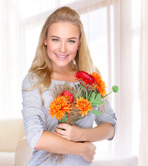 Happy woman with autumn flowers