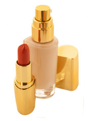luxury foundation and lipstick isolated on white