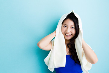 attractive asian woman on blue background