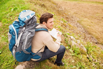 smiling man with backpack hiking