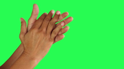 Two hands clap on green screen background
