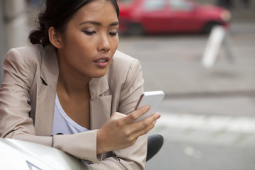 Woman texting on the phone
