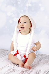 Little baby girl wearing Santa's hat