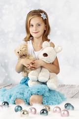 Pretty little girl celebrating christmas