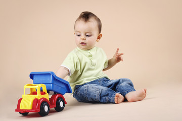 Little boy playing with car