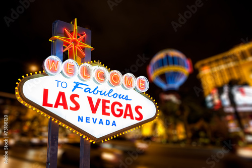 Leinwanddruck Bild Las vegas sign and strip street background