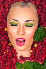 Beauty Makeup face in raspberries