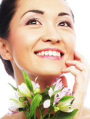 Beautiful asian woman with pink flowers