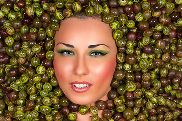 Beautiful female face in gooseberry