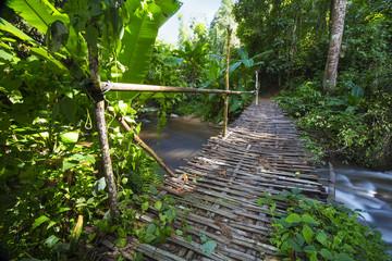 Wooden bridge cross the waterfalls, Lampang, Thailand