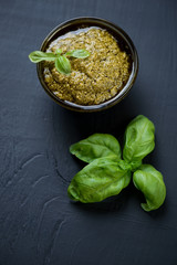 Freshly made basil pesto, vertical shot, high angle view