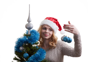 Beautiful girl decorates a Christmas tree