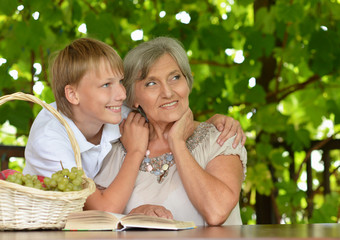 Grandmother reading with boy