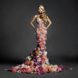 Leinwandbild Motiv Gorgeous lady in dress of flowers