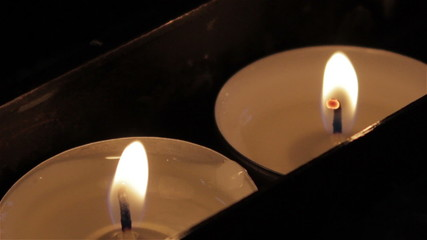 Two burning candles light is