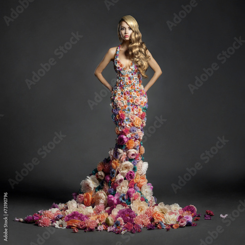 Gorgeous lady in dress of flowers - 73190796