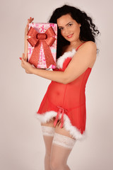Christmas girl with present, dressed in Santa Claus costume