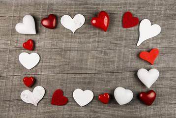 Rahmen mit Herzen in Rot als Hintergrund zu Weihnachten,Valentin