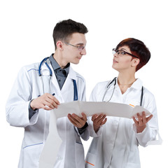 Two young doctors discuss the results of the electrocardiogram.