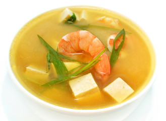 Spicy soup with shrimps and tofu isolated on white