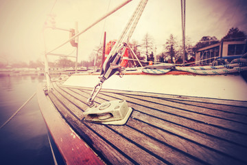 Vintage filtered close up picture of yacht rigging.