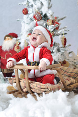 Kid in Santa Claus costume