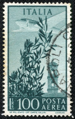 stamp printed in the Italy shows Plane over Capitol Bell Tower