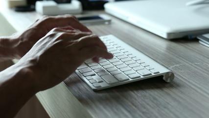 Man hand typing keyboard