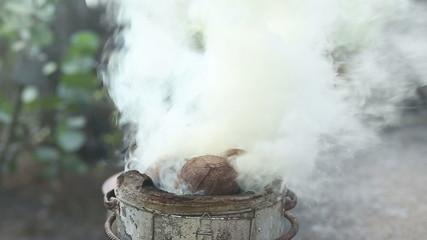 Smoke from burning coconut