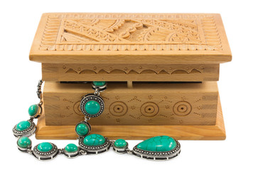 turquoise beads in a wooden box isolated on white background