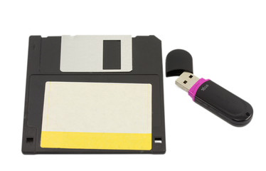 flash drive and floppy disk isolated on white background