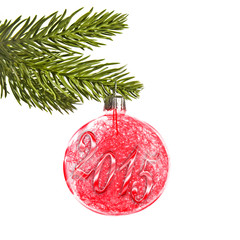 2015 on a red Christmas ball hanging on a tree