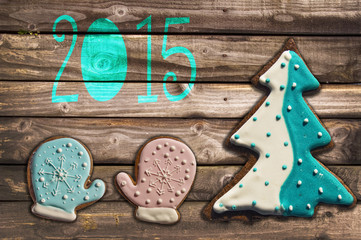 2015 gingerbread cookies on wooden background