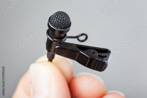 Hand holding Tie-Clip Microphone - 73195565