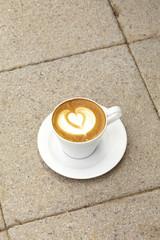 close up hot latte on concrete road