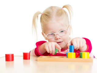 Child in eyeglases playing logical game isolated