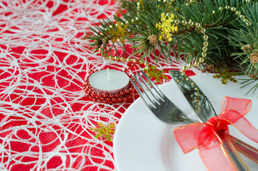 Christmas and New Year table place setting with christmas decora