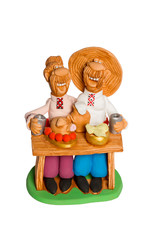 Statuette of two friends eating at the table