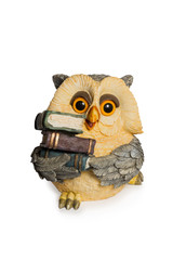 Figurine owl sitting with books