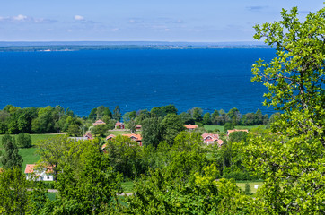 View of a lush landscape and the lake Vättern.