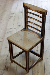 Old wooden chair on a wooden floor